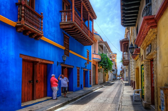 All the streets around old-town Cartagena look like this. The colors vary, but they are often strong, and lots of nice balconies. HDR of 3 handheld shots. This time Photomatix was not able to crisply align the images, but I insisted in using it because it is the only shot Ihave of this nice blue building. Cranked up the smart sharpen to make up the fuzziness, used Freaky Detail again (http://www.scottkelby.com/blog/2010/archives/8691), which is similar to Nik Tonal Contrast. For scenes with walls like these I prefer freaky detail because Tonal Contrast enhances the roughness of the walls too much. I masked the sky and street when applying freaky detail. Some dodging on the shadowed walls, and then Nik Skylight filter to give it a more sunny look.